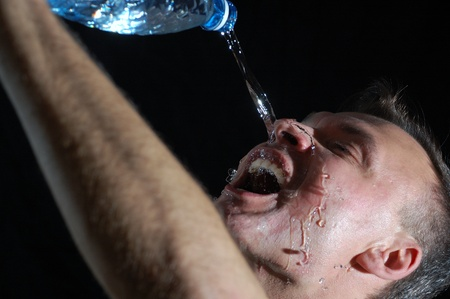 close-up studio portrait of a  man drinking water  photo