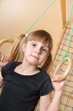 child playing at gymnastic rings photo