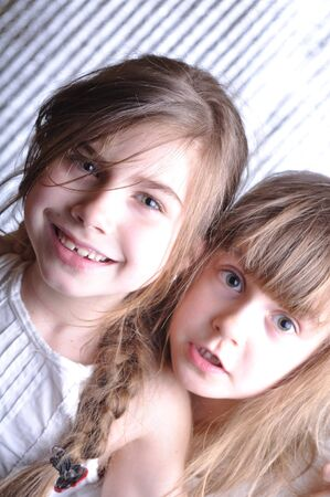close-up portrait of two 6-7 year old girls  Stock Photo - 9417465