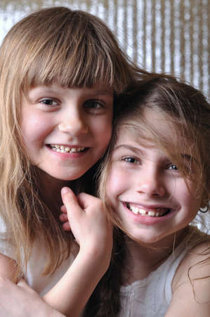 close-up portrait of two 6-7 year old girls  Stock Photo - 9482453