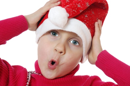 surprised girl wearing a Santa Clause hat photo