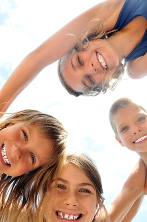 group of happy smiling kids playing together photo