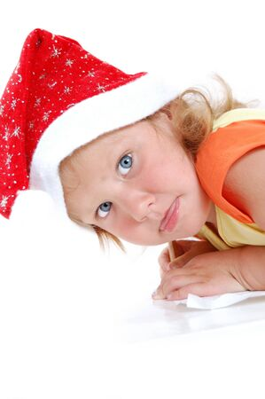 cute littel  girl writing a letter to Santa photo