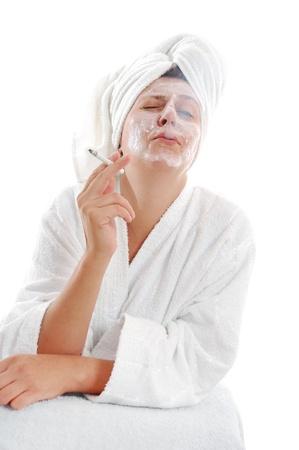 middle age woman in spa salon smoking a cigarette photo