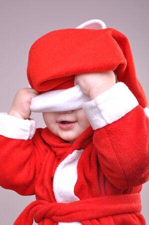 little  boy wearing a Santa  hat photo