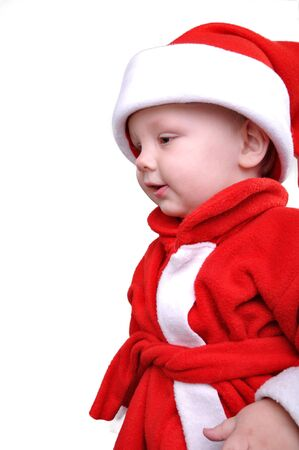 little  boy wearing a Santa Clause hat photo