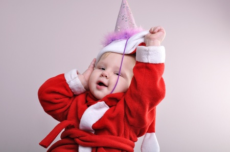 santa clause hat: adorable baby  boy wearing a Santa Clause hat Stock Photo