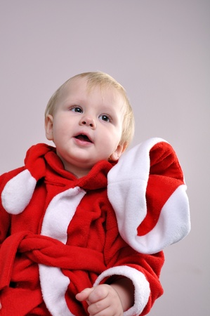 little  boy wearing a Santa Claus hat photo