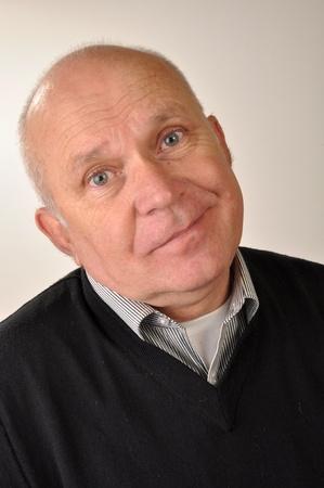 60 years old: Handsome senior man smiling. Studio shot.