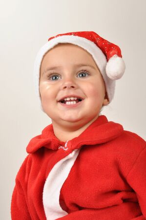 cute girl wearing a Santa Claus hat looking up photo