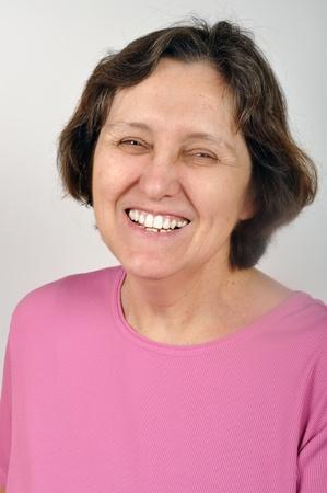 美しい幸せな笑みを浮かべて年配の女性 写真素材