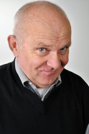 ironic: senior man with ironic face expression