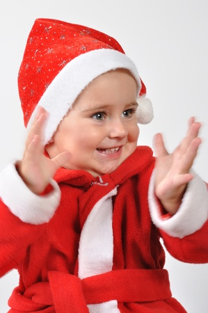 happy Christmas baby clapping hands and looking aside photo