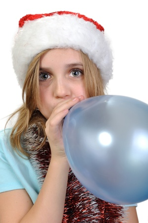 cute girl wearing a Santa  hatwith a balloon balloon photo