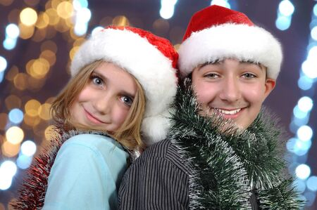 children with Santa hats  having fun and posing  photo
