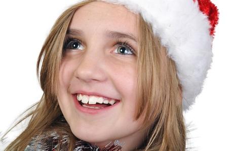 santa clause hat: cute girl wearing a Santa Clause hat