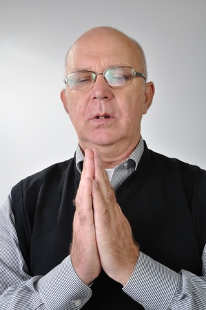 Clouseup portrait of elderly man praying with closed eyes. Stock Photo - 11849160
