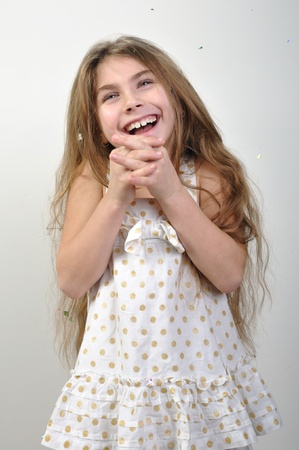 Beautiful 8 years old shines her smile out. photo