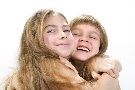 Studio portrait of two laughing hugging girls Stock Photo - 11976289