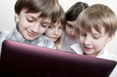 computer games: group of children friends playing computer games together