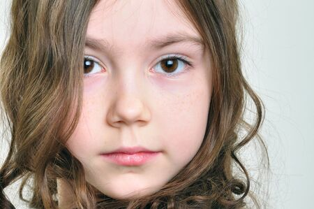 feeling up: close-up portrait of a beautiful  little  girl with long brown hair  Stock Photo