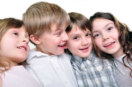 embracement: group of happy smiling kids playing and hugging together