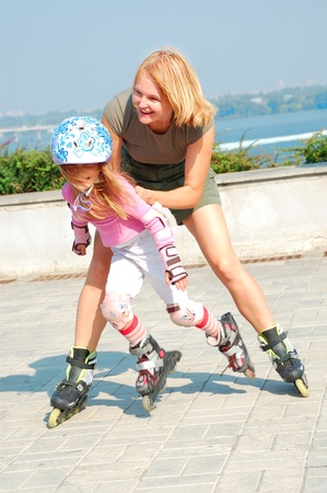 smiling 5 year old girl speedy going on her in-line skates  photo