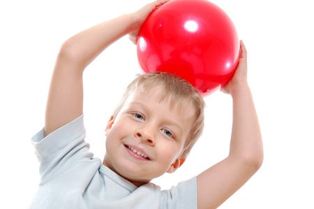 caucasian 5 year old boy with a red ball over white Stock Photo - 12956753