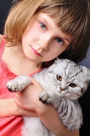 beaituful child girl with her pet cat together photo