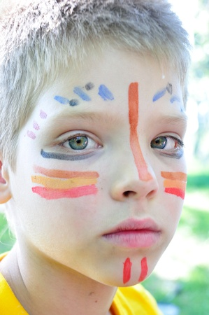 boy child with football fan paintings on face photo