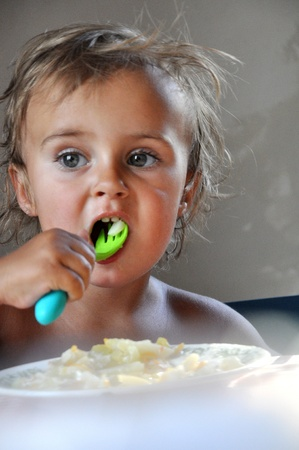 untidily: eating toddler girl Stock Photo