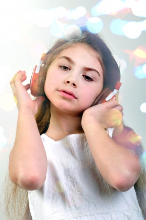 child with headphones listening to music photo