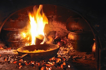 noone: pots and pans in a nold cooking fireplace