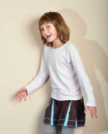 elementary age girl: portrait of a cute elemetary age girl having fun