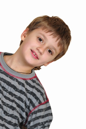 crazy face: portrait of smiling Cauacasian elementary age boy