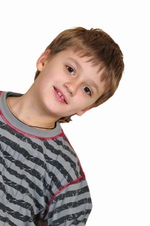 caras chistosas: Retrato de muchacho sonriente edad elemental Cauacasian