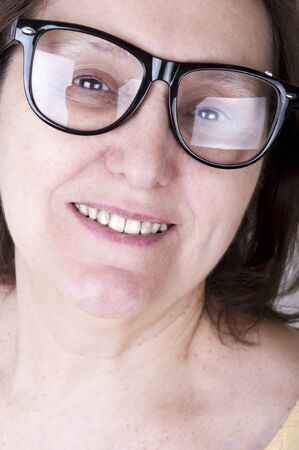 protecting spectacles: portrait of a smiling senior woman with glasses