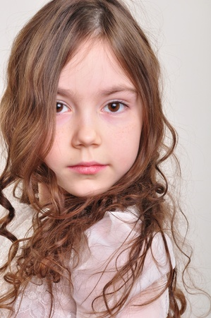 8 year old girl: portrait of a pretty 8 year old girl looking at camera