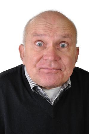 portrait of a senior man making faces