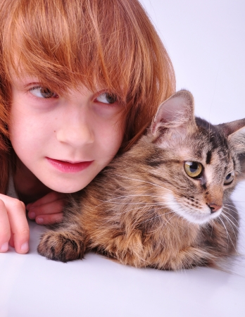 surprised child and her cat looking aside