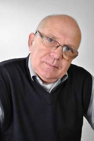 protecting spectacles: portrait of a senior man with glasses