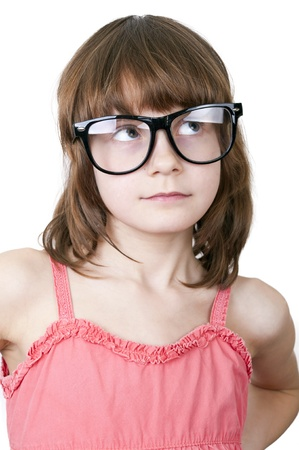 protecting spectacles: Cute thoguhtful child with funny glasses. Isolated over white background.