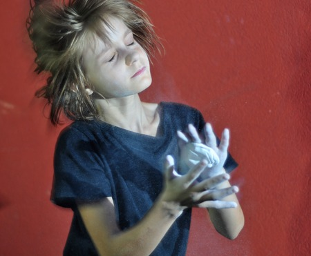 magnesia: child with a ball of powder magnesia chalk preparing for sports
