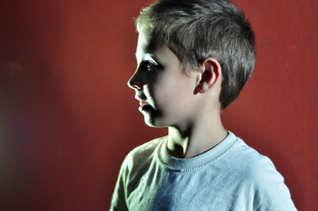 8 years: Profile portrait of a small boy  Hard light Stock Photo