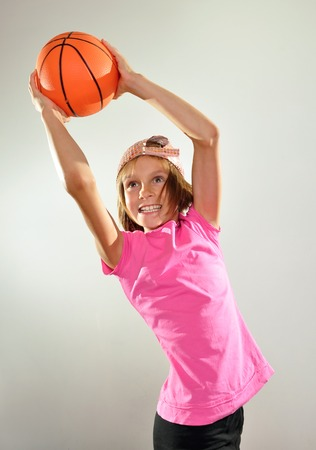 10 years old:  little 10 years old  girl exercising with a ball Stock Photo