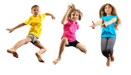 group of happy children jumping and having fun isolated over white