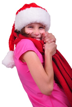 Child with Santa Claus red hat photo