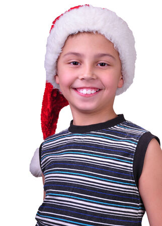 Child with Santa Claus red hat. Christmas, New Year celebration photo