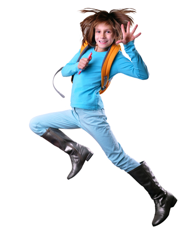 junior high: happy schoolgirl with a backpack and pens exercising and jumping. Isolated over white background