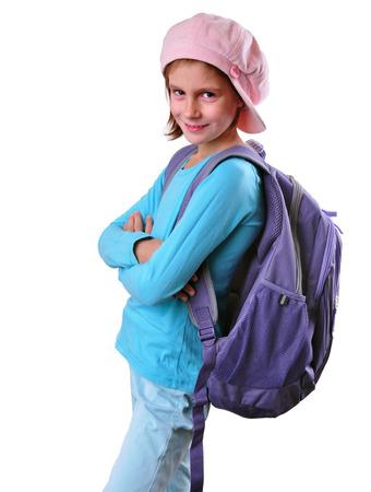 niño con mochila: Retrato de la sonrisa de colegiala posando con mochila. Aisladas más de fondo blanco